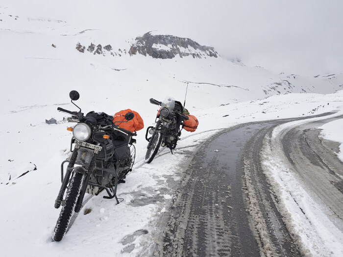 Our Royal Enfield Himalayans in the snow on Bara-lacha La Pass. Photo © Karl Rock, all rights reserved.