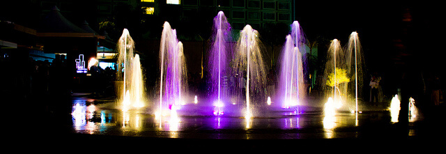 Fountain at the entrance of UB City at night