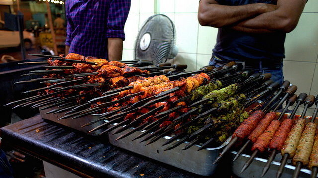 Different types of BBQ'd chicken skewers in India. Photo by Travis Wise.