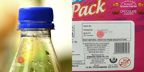 Maximum Retail Price (MRP) highlighted in red on a drink bottle and back box of sweets.